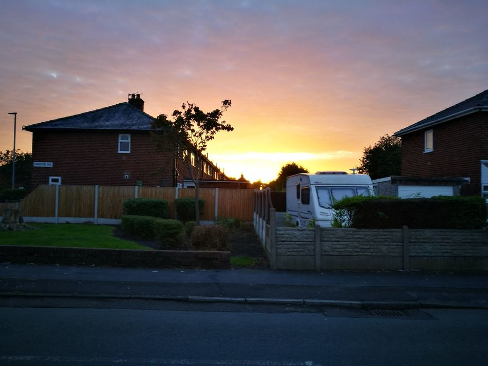 Warrington, England Sky Architecture Cloud Sunset Colour Of Life Taking Photos Outdoors Enjoying Life Building Exterior Architecture Built Structure Sunset Residential Structure House Tree Road Sky Lawn Cloud Orange Color Cloud - Sky Outdoors Sun Sunbeam