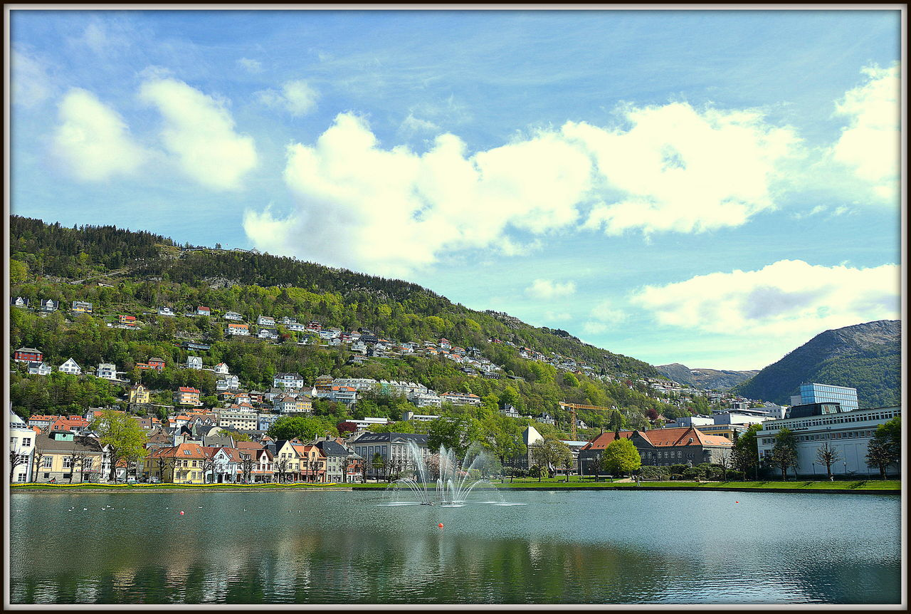 building exterior, built structure, sky, water, architecture, cloud - sky, mountain, waterfront, day, house, river, nature, outdoors, no people, town, beauty in nature, scenics, mountain range, tree