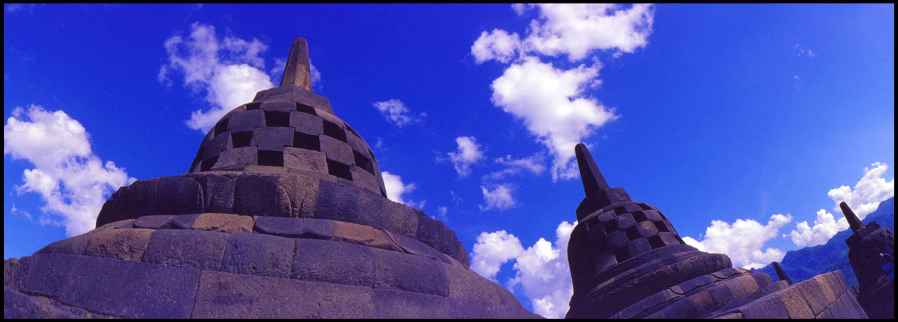 sky, low angle view, religion, architecture, built structure, cloud - sky, building exterior, place of worship, spirituality, day, outdoors, no people, history, blue, travel destinations, statue