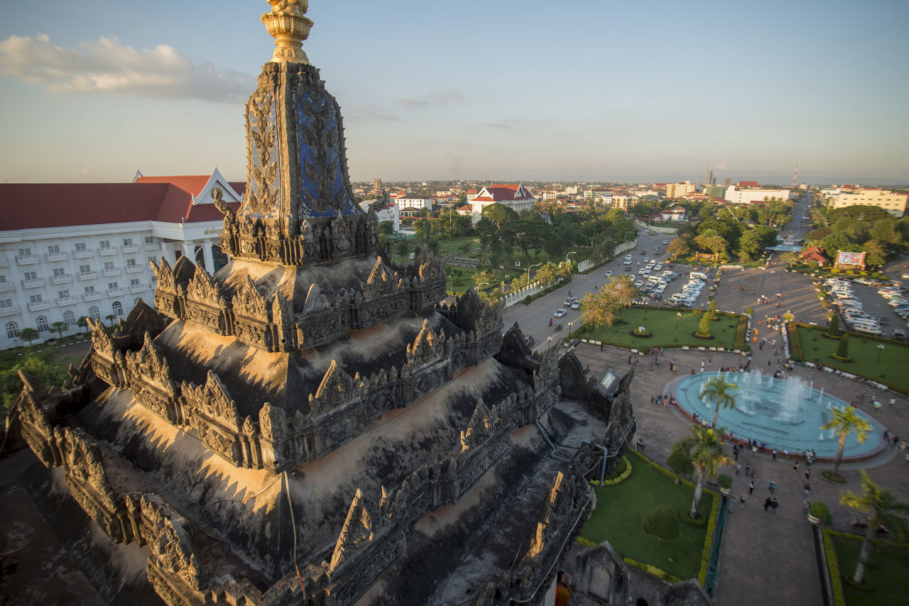 statue, architecture, sculpture, built structure, building exterior, history, religion, spirituality, sky, high angle view, outdoors, no people, travel destinations, cityscape, city, day, water, nature