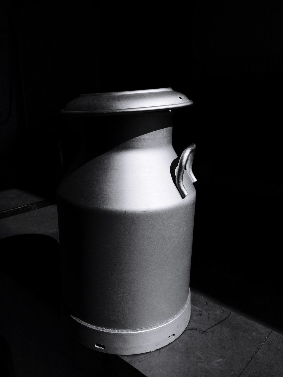 Metal Milk Jugs In Darkroom