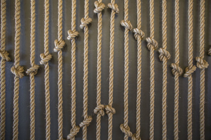 Many vertical ropes with knots as decoration Brown Background Cannabis Lines Backgrounds Close-up Day Full Frame Handy Craft Knots Knots And Lines No People Pattern Prison Rope Ropes And Lines Strength Together Strong Up And Down Vertical Lines Vertical Symmetry Zick Zack