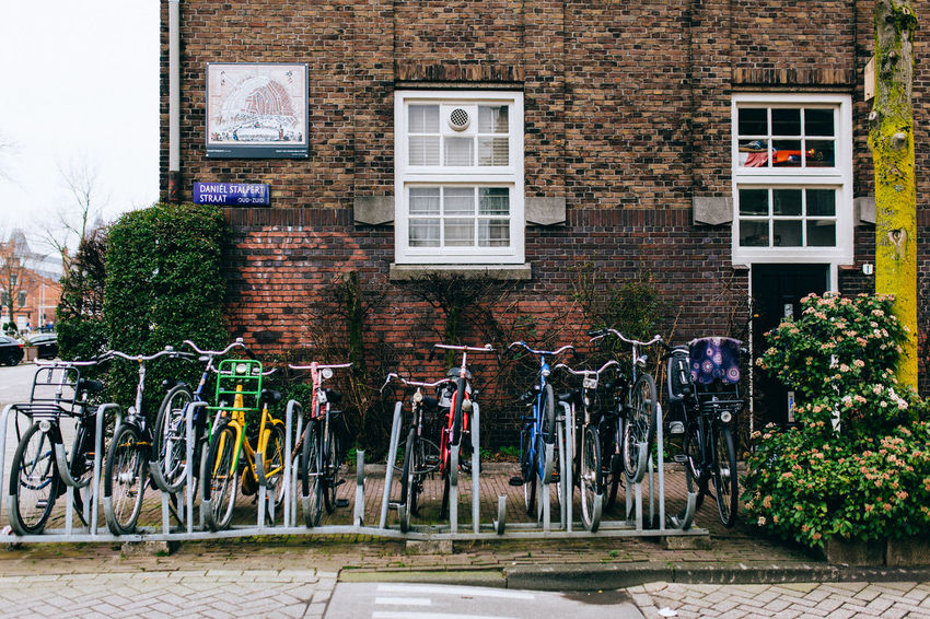 A Wintery Amsterdam... All Streets Amsterdam Architecture Bicycle Building Building Exterior Built Structure City Day Door Graffiti House Outdoors Plant Residential Building Residential Structure Street Text Transportation Wall - Building Feature Western Script Window Your Amsterdam