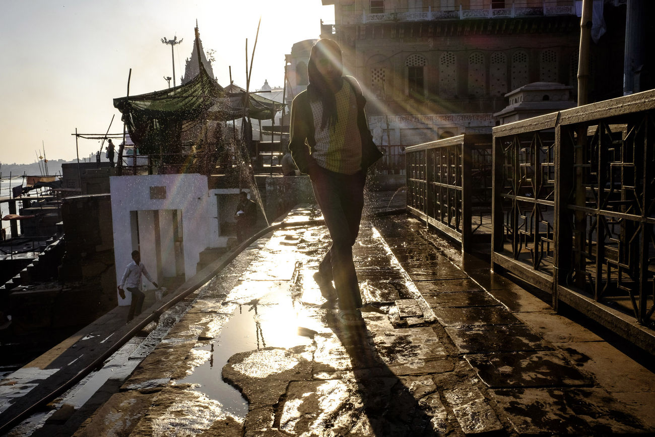 Man walking along the ghats in Varanasi, India ASIA Benares Day Ganges Ganges River India Light From Behind Men One Person Outdoors People Rear View Sunshine Travel Varanasi Varanasi Ghats Varanasi, India Ganges, Indian Lifestyle And Culture, Bathing In The Ganges, Varanasidiaries Walking