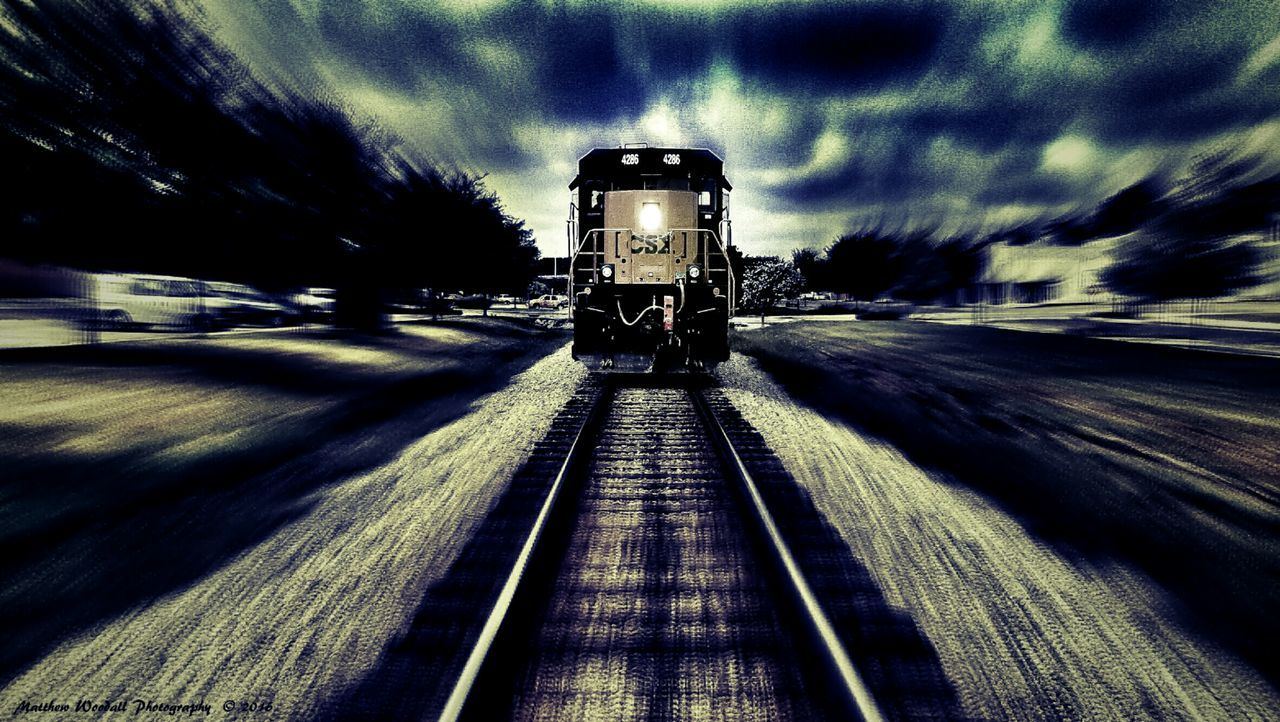 """Dead on track 2"" This is a new edit on a photo that I posted a couple of days ago entitled 'Dead on track '. In the other one it shows it as it was when I took the photo in the cloudy afternoon, but being that the trains headlight was on clearly, I thought that it might look cool if I could make it appear as if it were in the twilight time of the evening, right at the time it began to turn night time. So I decided to make it darker using a couple of filters in snapseed and also tuning the settings to darken it with the contrast and took out some brightness and also toned it down using the shadow settings, to give it just the right settings for a twilight appearance. I hope that you like my efforts. On other photo and social media websites people like it a lot and have given me great compliments on my editing efforts, and I can only hope that you all here will like it as well. I thank you sincerely if you do like my editing of this fast looking train at twilight. :-) ✌ Creative Photography Trainphotography Railfansofeyeem Railroad Track Fast Train Twilight Scene Twilightscapes Twilight Trains & Railroad Trains_r_the_best Trains Trains_worldwide Railways_of_our_world Railroad Love Trainride Trainstories Train_of_our_world Railfans_of_instagram Railfanning Fujifilmdigitalcamera Fujifilm Photoshop Edit Picasaedit Snapseed Picasa"