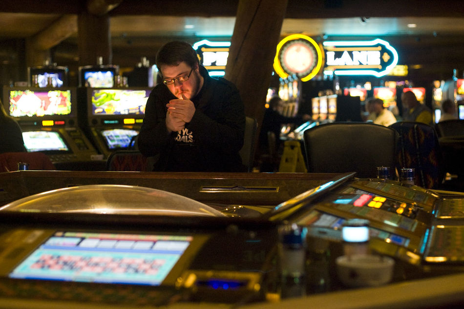 Chance Cigarette  EyeEm Best Shots Gamble Gambling Gambling Gaming Illuminated Indoors  Lifestyles Light Lighter Machinery Night Night Lights One Person People Real People Roulette Roulette Wheel Slot Machine Smoking Teen Teenager Young Adult