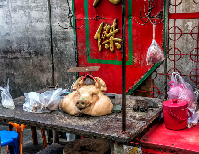 Street meat market with a pigs head in an alley. Alley Animal Themes ASIA Built Structure Day Dead Display Domestic Animals Food Fresh Indoors  Mammal Market No People Outside Pets Pig Poduce Pork Raw Red Street Table