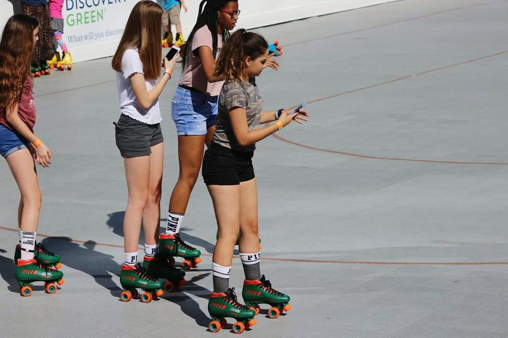 Put those phones away and have some fun! 😆😃 Friendship Sport Lifestyles Leisure Activity Outdoors People Young Women Standing Sports Clothing Togetherness Technology HoustonTX Kids Photos On The Street Discovery Green Roller Skating Skatingrink Popular Photos Canonphotography Photography Eyemphotography Young Adult Healthy Lifestyle
