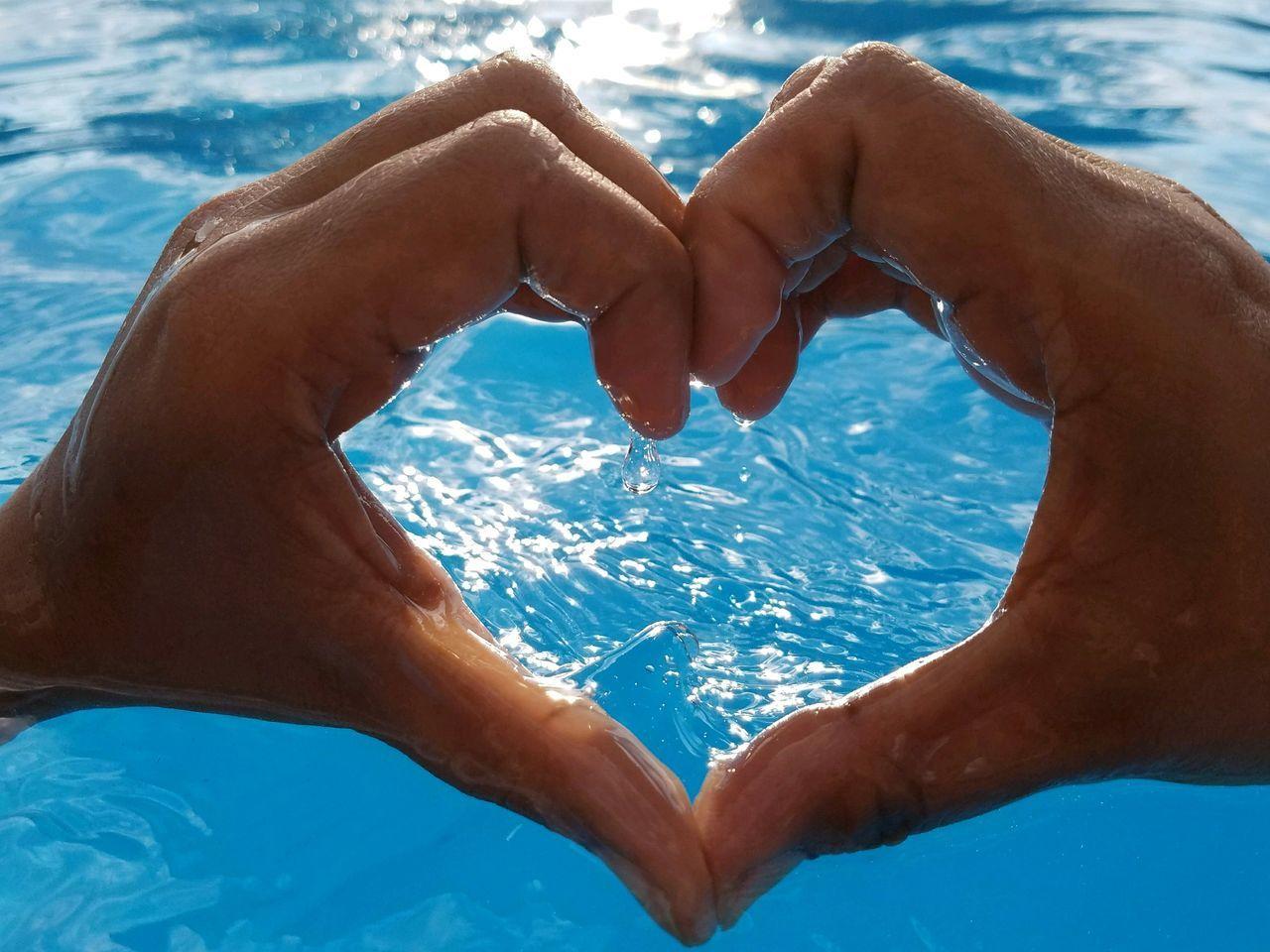 Love, what's that?Human Body Part Swimming Pool Water Human Hand EyeEm EyeEm Best Shots Bokeh Getting Inspired BlueEyeEm Selects Sommergefühle