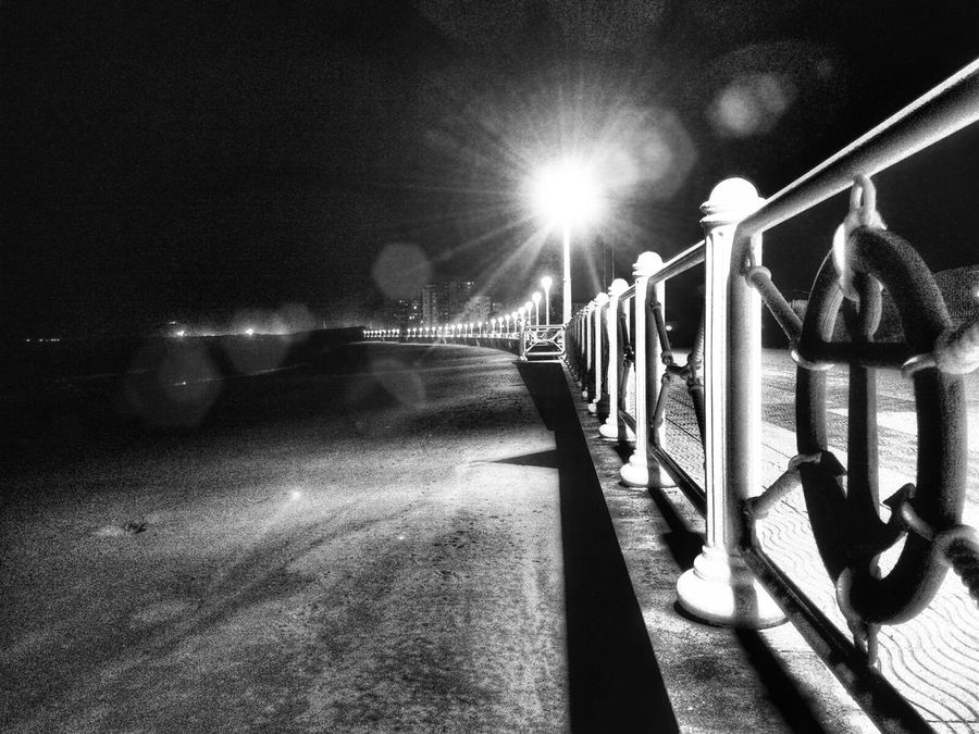 The beach Sleeps. Night view of the seafront promenade Beach Life Blackandwhite Photography Connection EyeEm Black&white! Glowing Horizontal Insomniaphotography Life Is A Beach Light In The Night Long Night View Nightphotography Showcase: January Sparkle The Way Forward