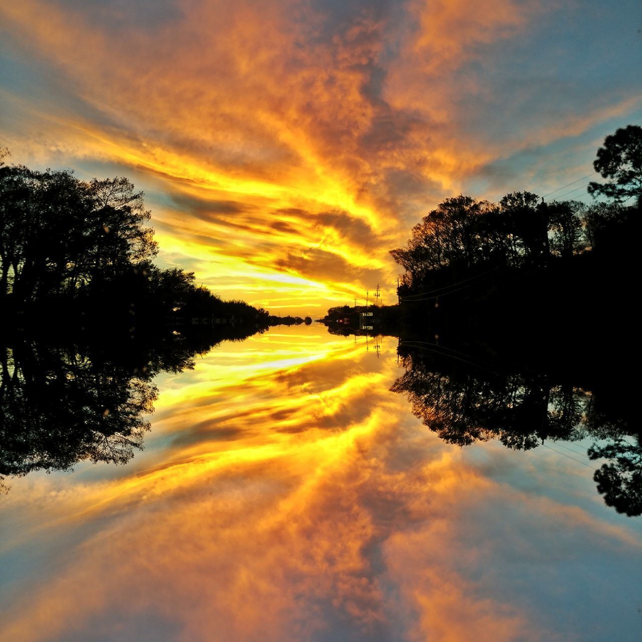 reflection, sky, sunset, cloud - sky, tree, water, orange color, beauty in nature, scenics, nature, silhouette, waterfront, tranquil scene, dramatic sky, outdoors, tranquility, no people, lake
