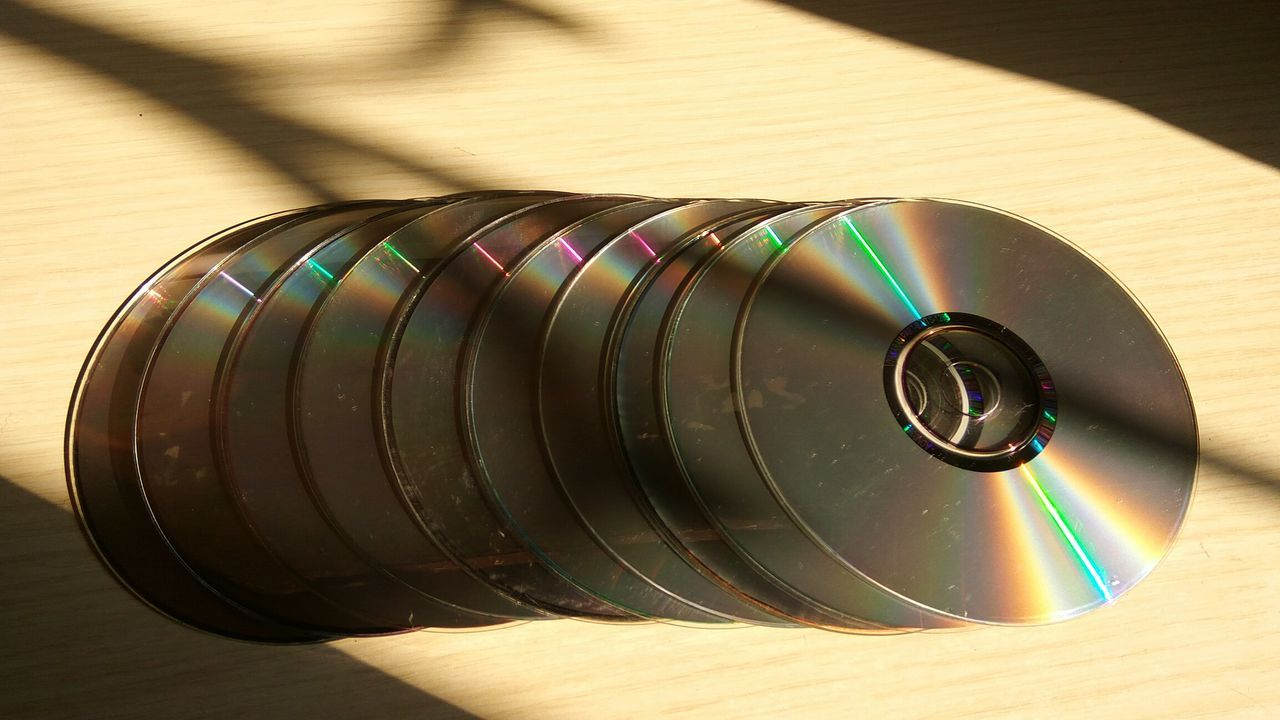 💿✨🔆Beautifully Organized Sunkissed☀ Discs Tabletop Taking Photos Sunshine Bright_and_bold Bright Light Check This Out Hello World Enjoying Life Eyeem Collection EyeEm Best Shots Eyeem Photography Night Photography From My Perspective From My Lens Rainbow Colors Shiny Circles CDs Eyeem Market EyeEm Best Edits Darkness And Light Simple Things Are The Best