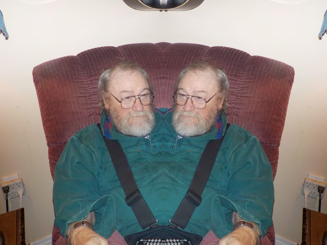 senior adult, senior men, eyeglasses, two people, front view, beard, indoors, home interior, looking at camera, casual clothing, happiness, senior women, togetherness, smiling, portrait, real people, sitting, senior couple, day, young adult