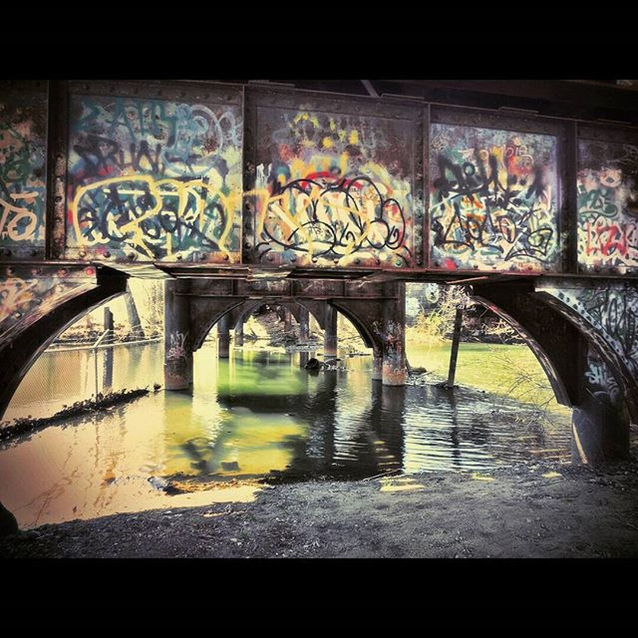 Filtered (w/ Pixlr ) view under a railroad bridge in Pittsfield, MA. : : Pittsfield PittsfieldMA IntheBerkshires Berkshires Theberkshires Igers413 Igersnewengland Igersmass Urbanexploration Urbanabstractions Streetshooter Streetphotography RailRoadTracks Traintracks Railroad Industriallandscape Urbanlandscape ExploreEverything Newtopographics Yetmagazine Noicemag Onbooooooom Rentalmag Createdaily abstractphotography wanderlust picoftheday PhotoOfTheDay Overfiltered