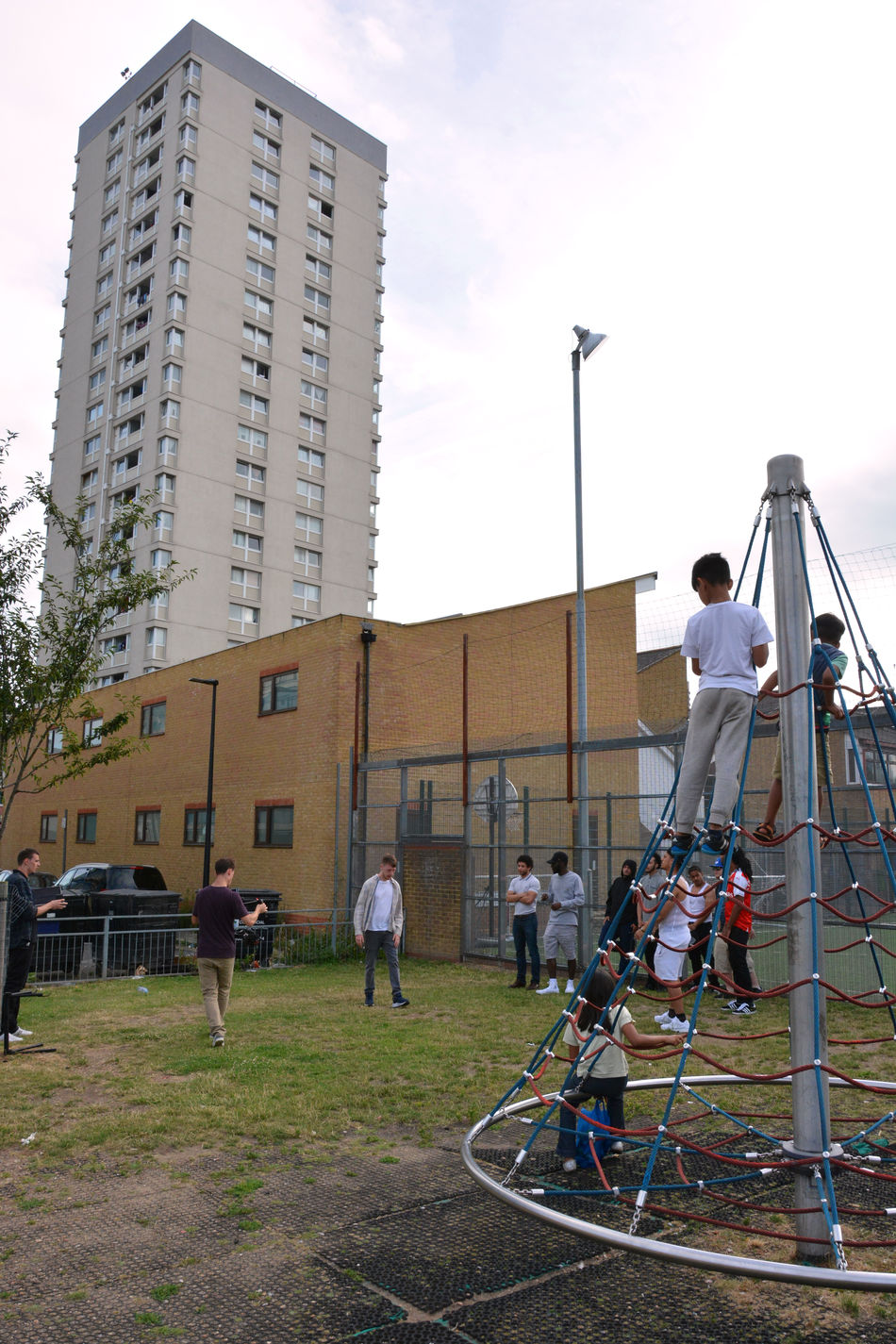 EAST LONDON VIBES Architecture Building Built Structure Casual Clothing Children City City Life Cloud - Sky Day Grass Group Of People Kids Leisure Activity Lifestyles Medium Group Of People Mixed Age Range Outdoors Sky