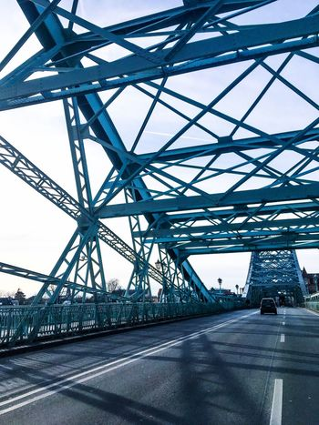 The blue wonder bridge in dresden/germany. Blue Building Exterior History Through The Lens  Structures & Lines Streetphotography Out Of Car Window Blue Metal Bridge Out Of Car Iphonephotography Blue Wonder Bridge Dresden Bridge - Man Made Structure Connection Built Structure Transportation Architecture Metal Road City No People Sky Travel EyeEmNewHere AI Now EyeEm Ready   EyeEmNewHere An Eye For Travel Press For Progress