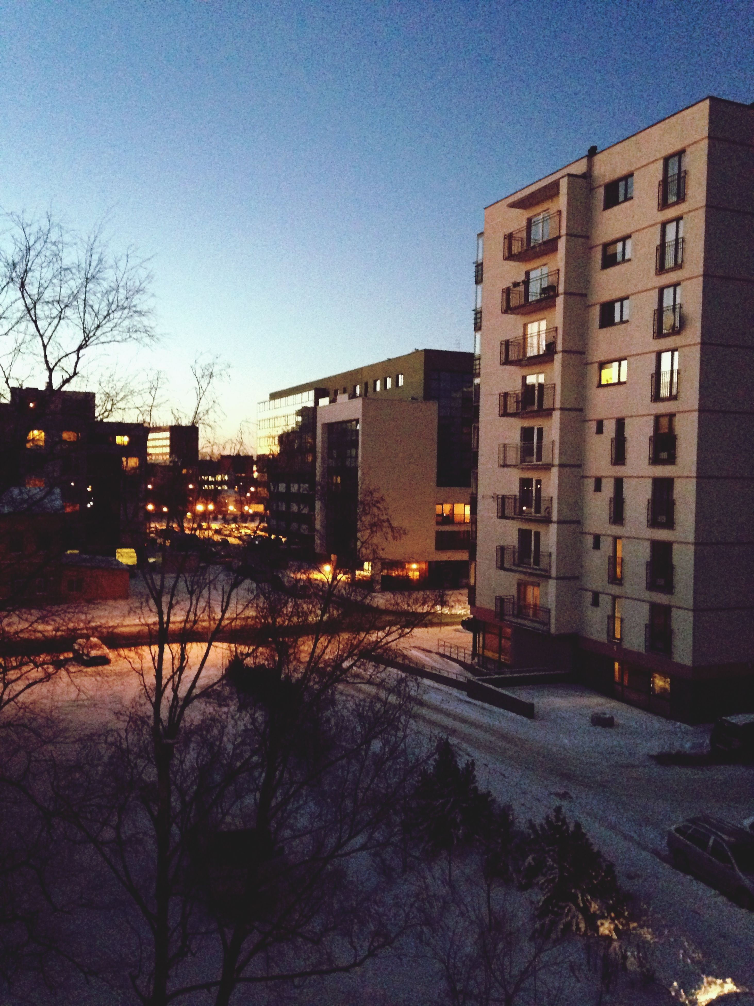 building exterior, architecture, built structure, bare tree, snow, winter, cold temperature, clear sky, city, season, residential building, residential structure, tree, street, house, building, residential district, sky, outdoors, dusk