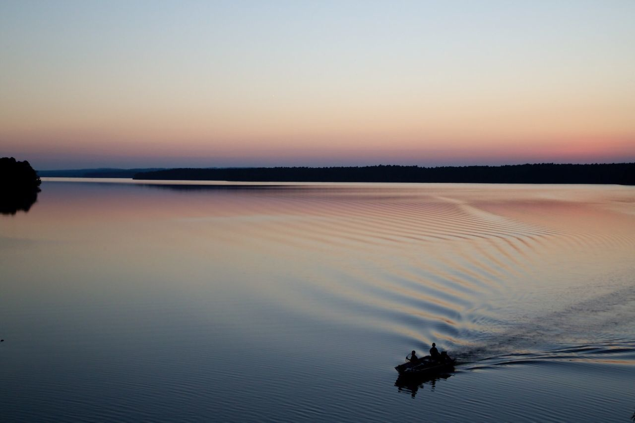 Sunset Lake View Fishing Boat