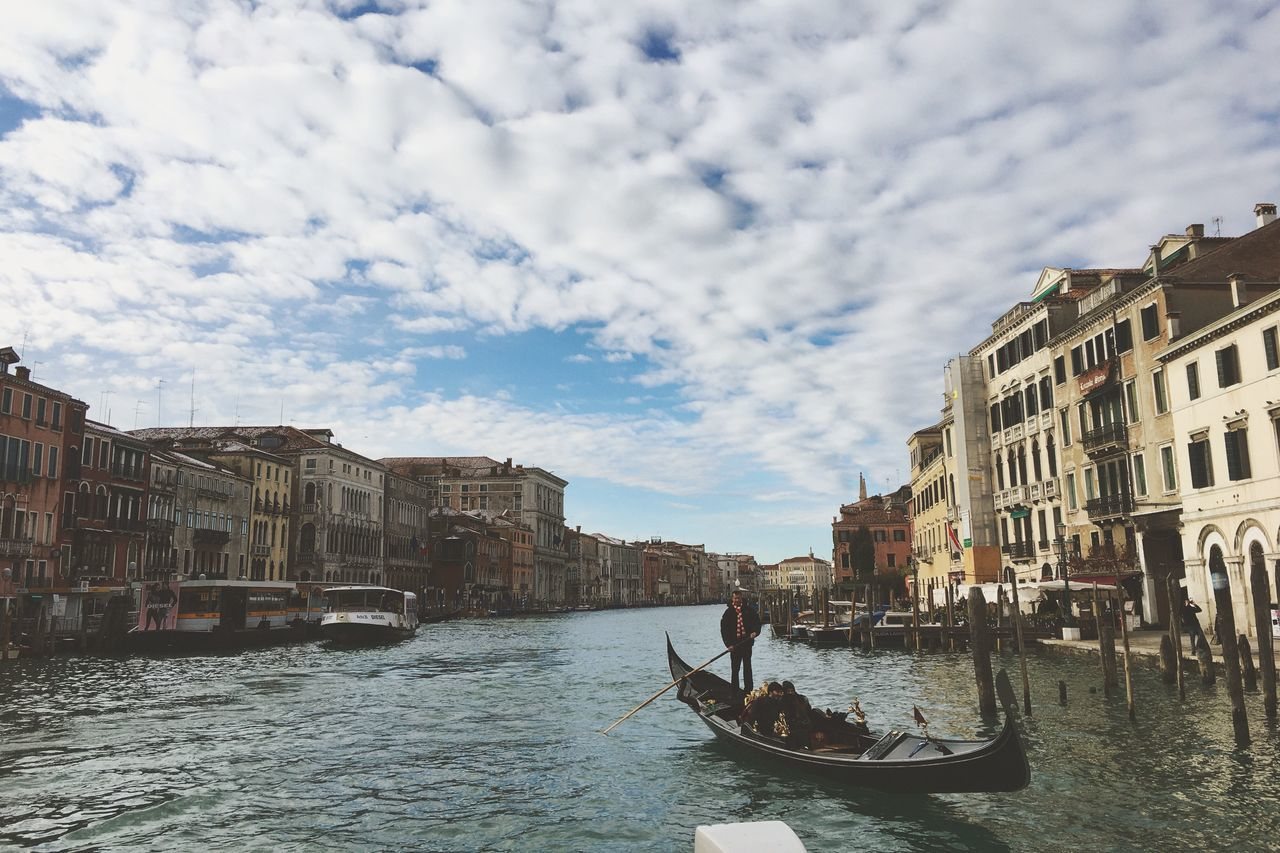 Building Exterior Architecture Gondola - Traditional Boat Canal Built Structure Gondolier Nautical Vessel Cloud - Sky Gondola Day Transportation Mode Of Transport Sky Outdoors Travel Destinations Water One Person City One Man Only People Venice