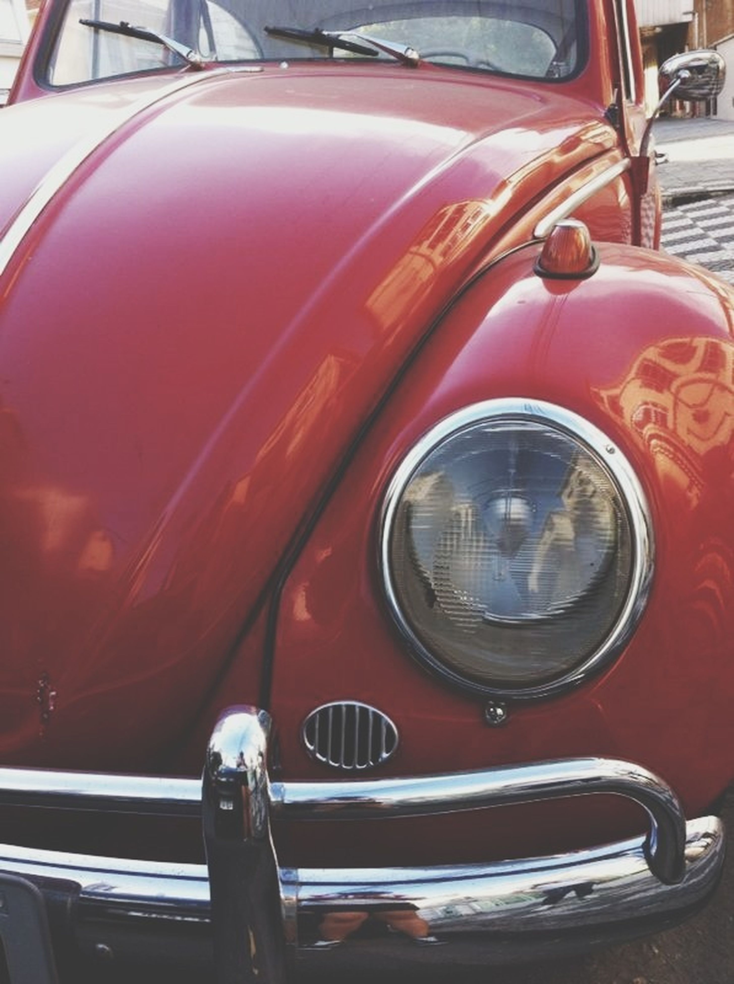 transportation, mode of transport, land vehicle, car, travel, stationary, headlight, vintage car, vehicle interior, part of, red, parking, street, parked, on the move, old-fashioned, side-view mirror, day, no people, close-up