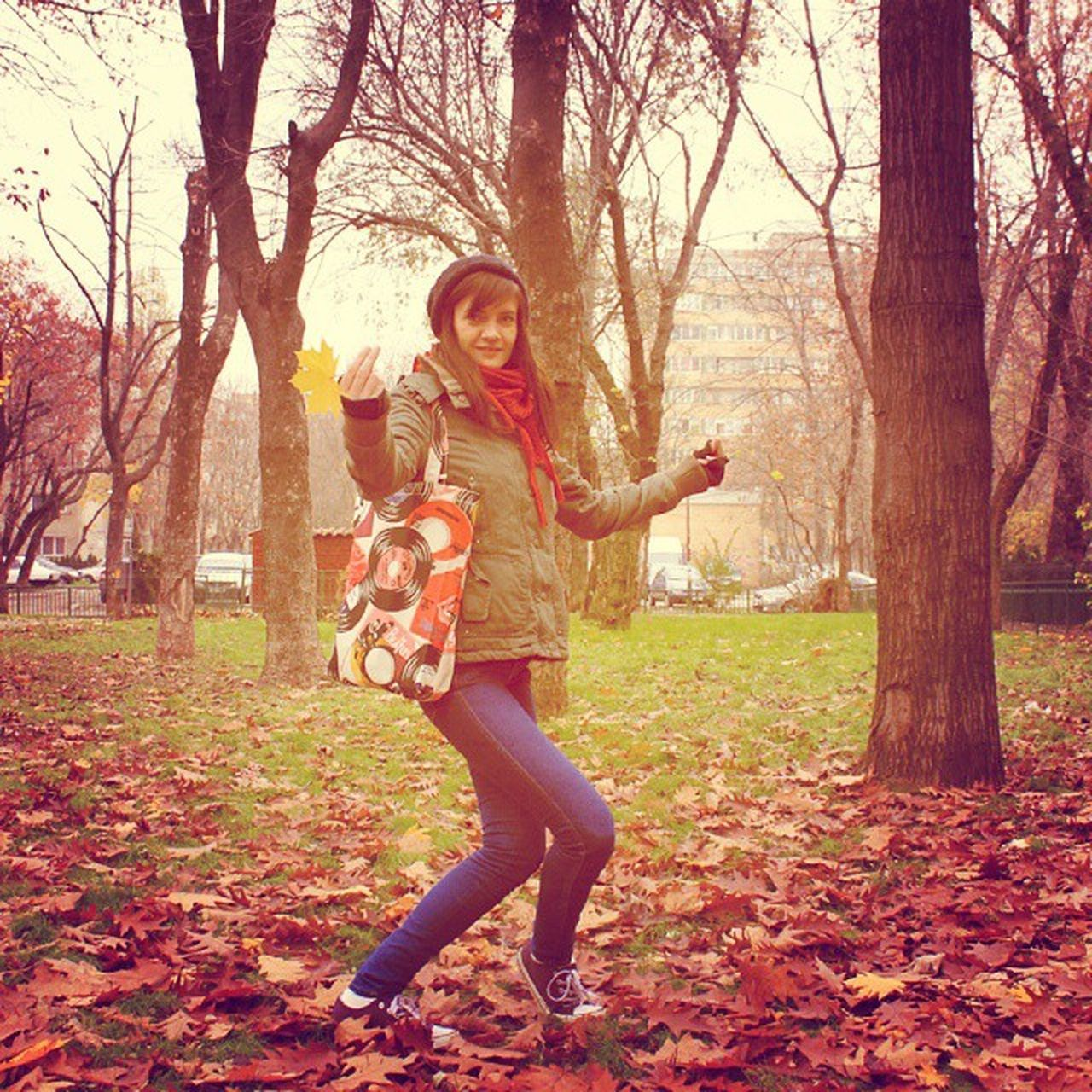 autumn, tree, fashion, smiling, full length, casual clothing, lifestyles, women, standing, cheerful, fun, adult, happiness, nature, only women, young adult, outdoors, leisure activity, young women, arts culture and entertainment, portrait, looking at camera, leaf, motion, adults only, people, day, real people, beauty in nature, musician