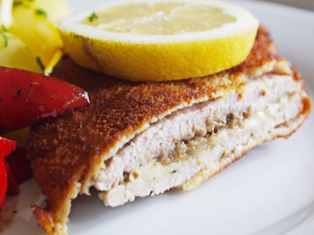 Bread Breaded Cutlet Close-up Cordon Bleu Day Food Food And Drink French Food Freshness Indoors  Lemon Slice No People Plate Ready-to-eat Sandwich Schnitzel SLICE