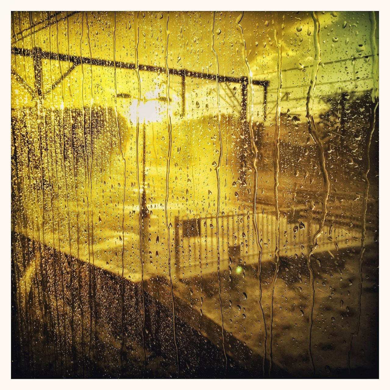 Close-Up Of Wet Glass Window During Sunset In Monsoon
