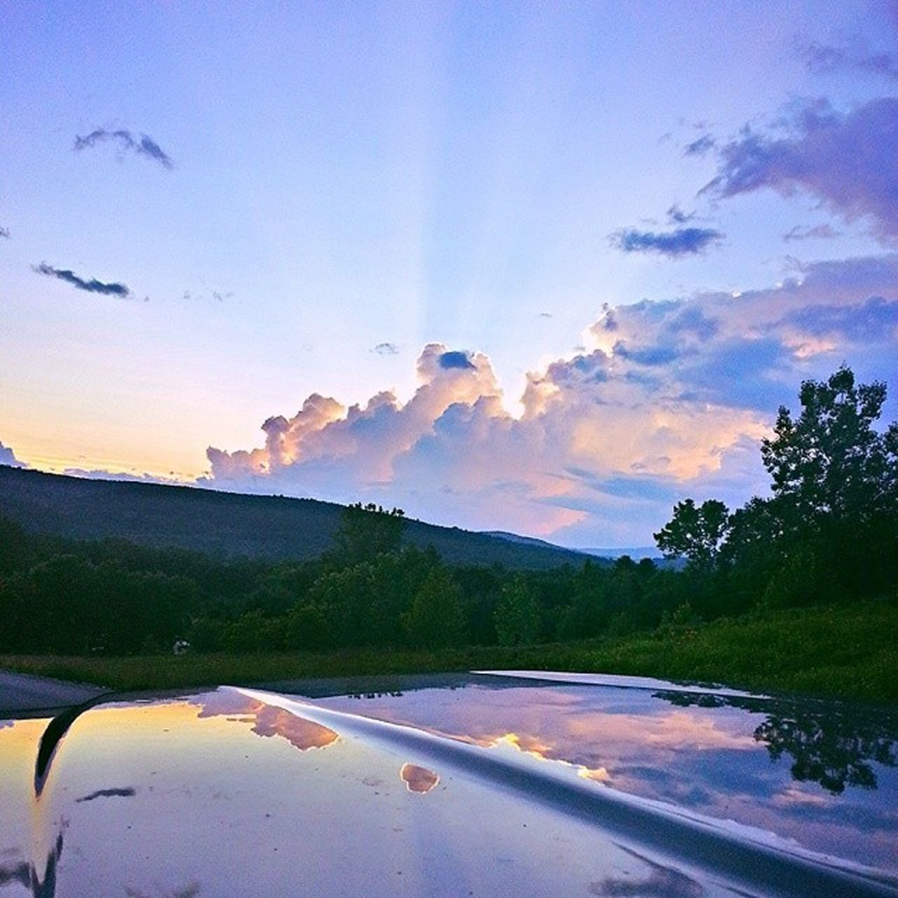 One of my favorite shots. Love the way the sky reflects on the tonneau cover. Taken near my house this summer. Seriously missing those warm, colorful summer nights. TBT  Charlestown NH 603 Newhampshire Igersnh Officialnhgram SummerNights Reflection Colorfulsky