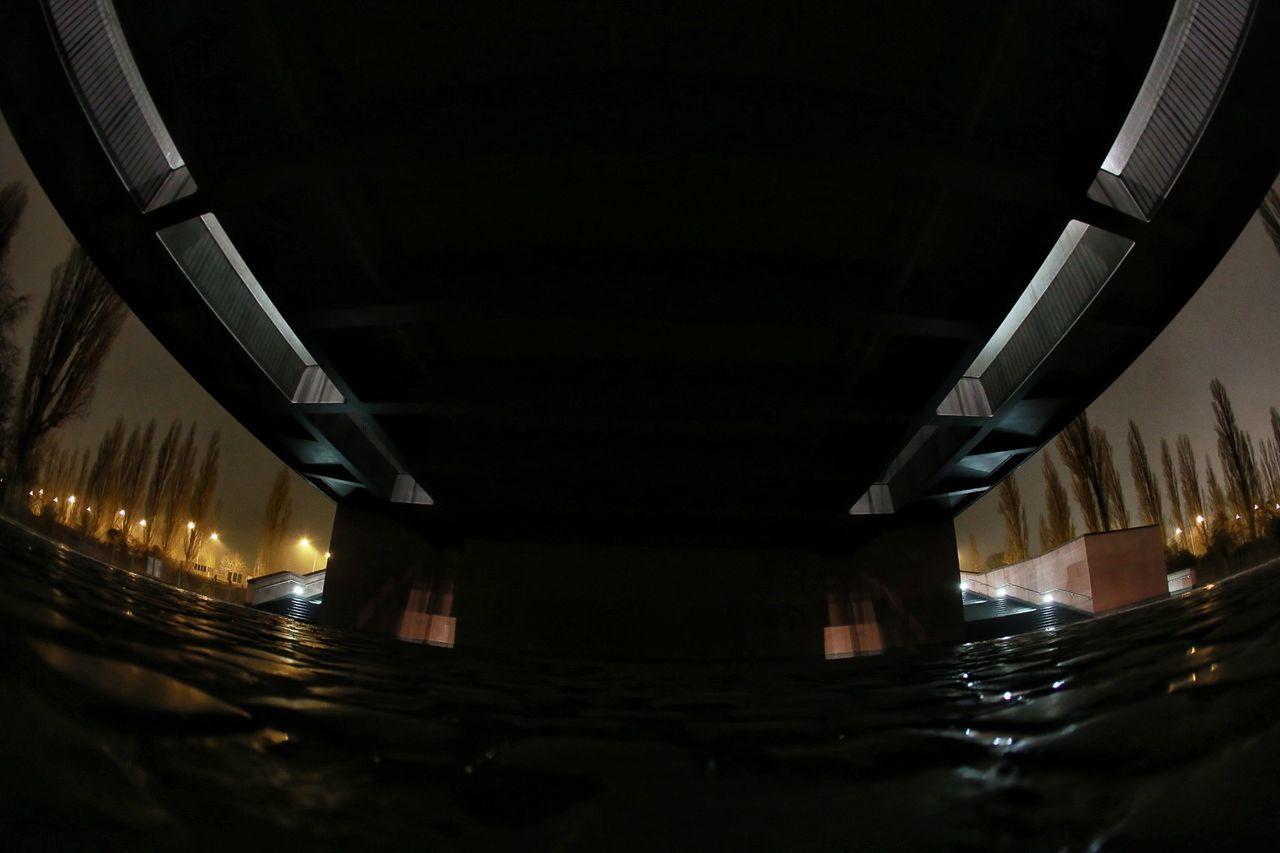 under the bridge Illuminated Night Bridge - Man Made Structure No People Outdoors Sky Shadows & Lights Shadow And Light Black Background Shadow Dark Looking Up Fisheye FishEyeEm Frankfurt City Bridge Low Angle View Cobblestone Mutated Shape Distorted Architecture Streetphotography