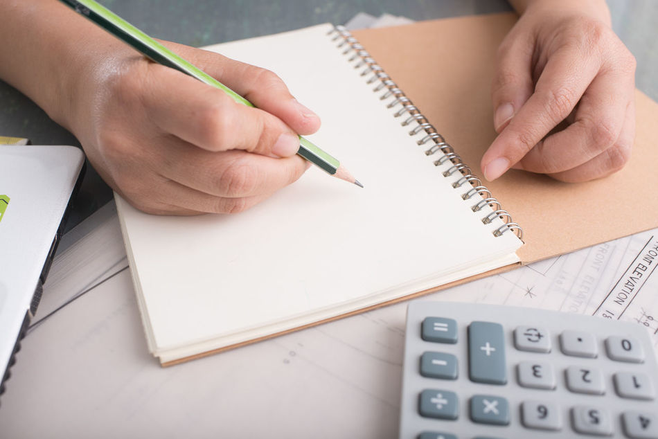 Book Close-up Day Desk Diary Education Holding Human Body Part Human Hand Indoors  Learning Note Pad One Person Page Paper Pen Pencil People Real People Spiral Notebook Student Table Writing