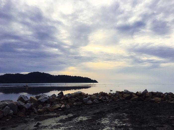 Water Sea Sky Nature Beauty In Nature Scenics Tranquil Scene Cloud - Sky Beach Tranquility Rock - Object Outdoors No People Horizon Over Water Day Pebble Beach
