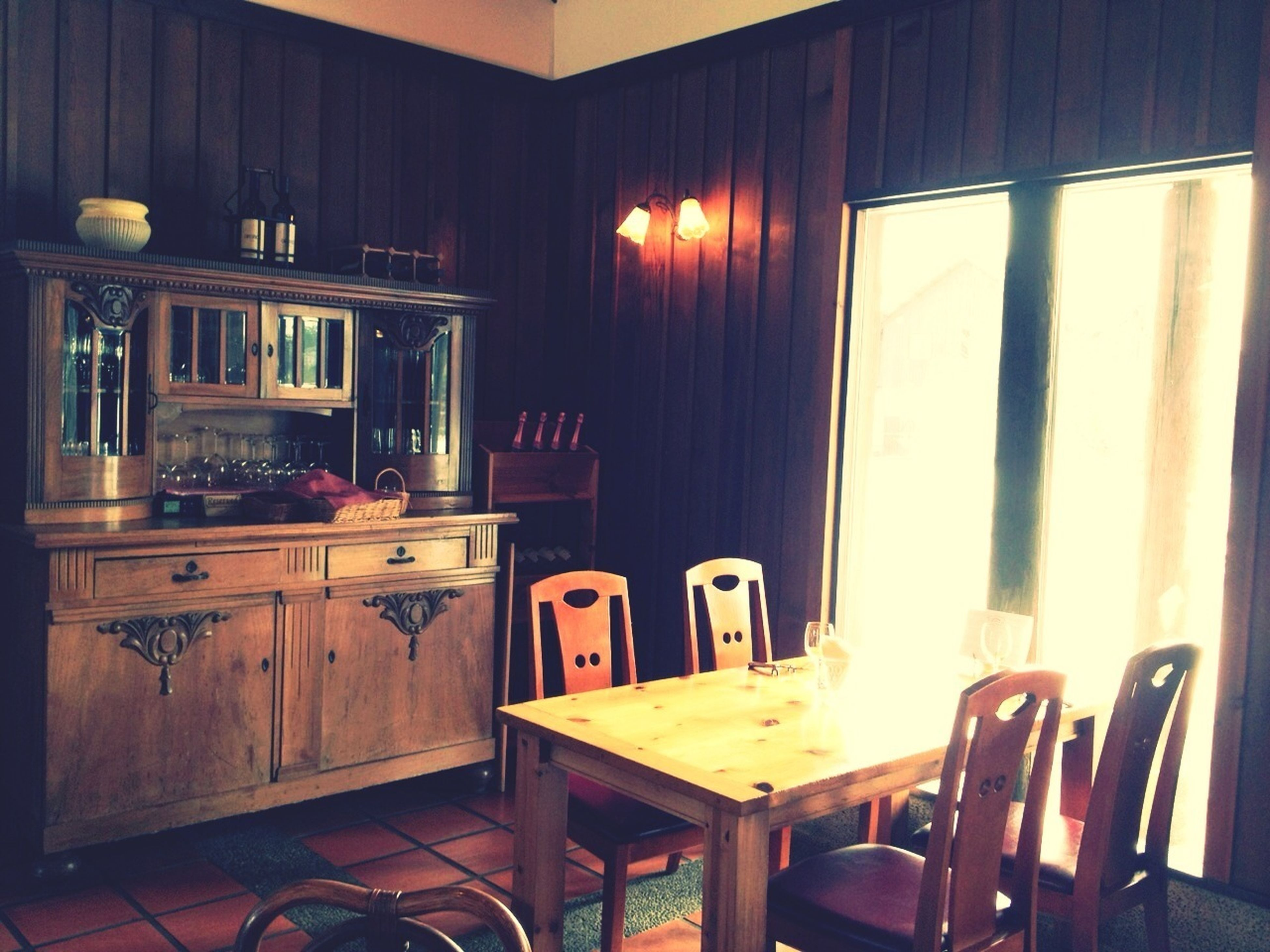indoors, window, chair, absence, table, empty, home interior, architecture, built structure, interior, wood - material, no people, house, furniture, old-fashioned, shelf, door, glass - material, old, restaurant
