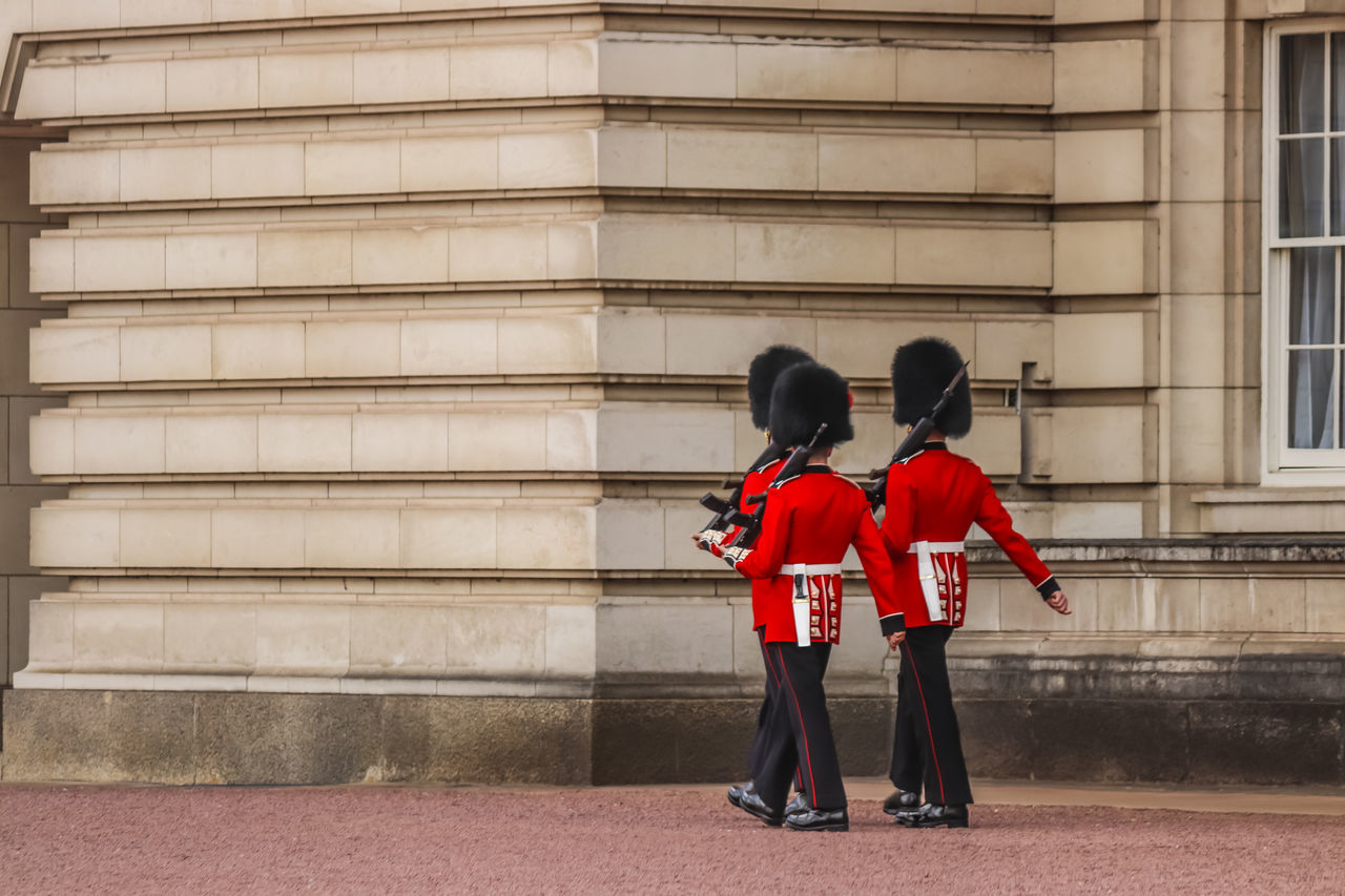 Marching at the palace. British Army Buckingham Palace Day In Step Marching Men Military Outdoors People Queen's Guard Real People Red Soldiers Togetherness