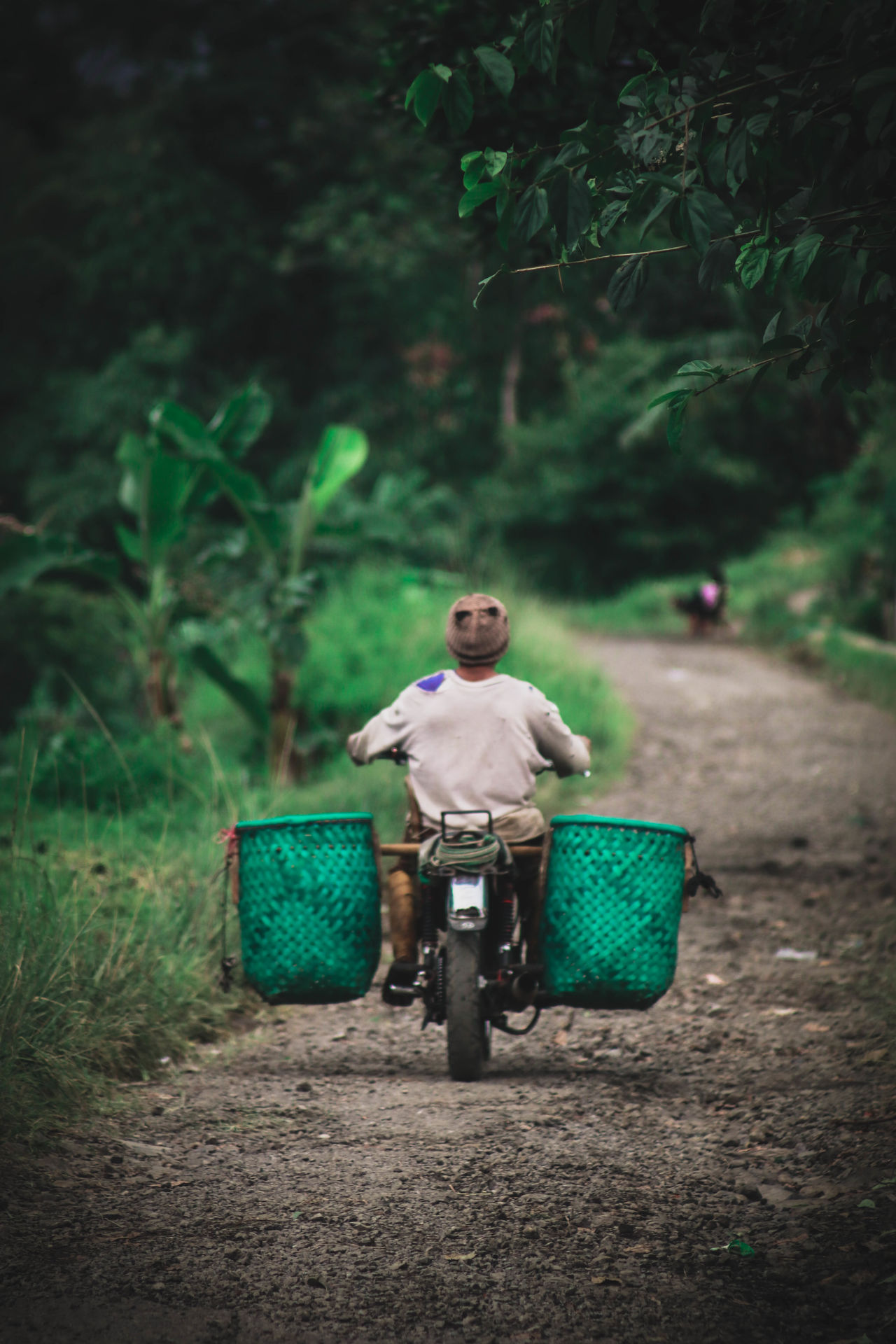 Activity Day Full Length Green Color Human Humaninterest Humaninterestindonesia Humaninterestphotography Men Nature One Person Outdoors People Real People Road Traditional Transportation Transportation Tree