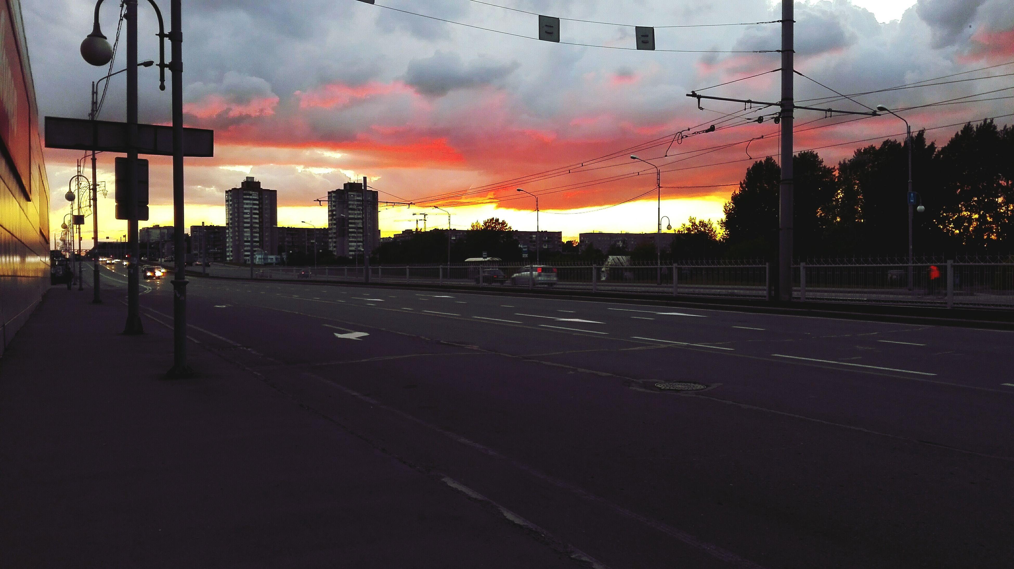 sunset, sky, building exterior, cloud - sky, architecture, orange color, built structure, transportation, city, the way forward, road, street, cloudy, street light, electricity pylon, dusk, dramatic sky, silhouette, cloud, empty