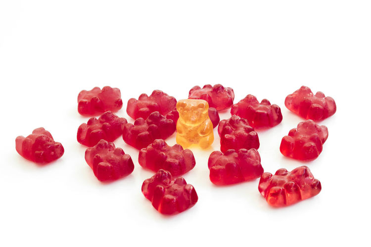 Detail of group of gummy bears, where a different one is standing. White isolated background Bear GummyBear Individuality Backgrounds Candy Colorful Delicious Different Goodies Gummy Gummy Bears Gummybears Jelly Sweets Unique Uniqueness Wallpaper White Background White Isolated