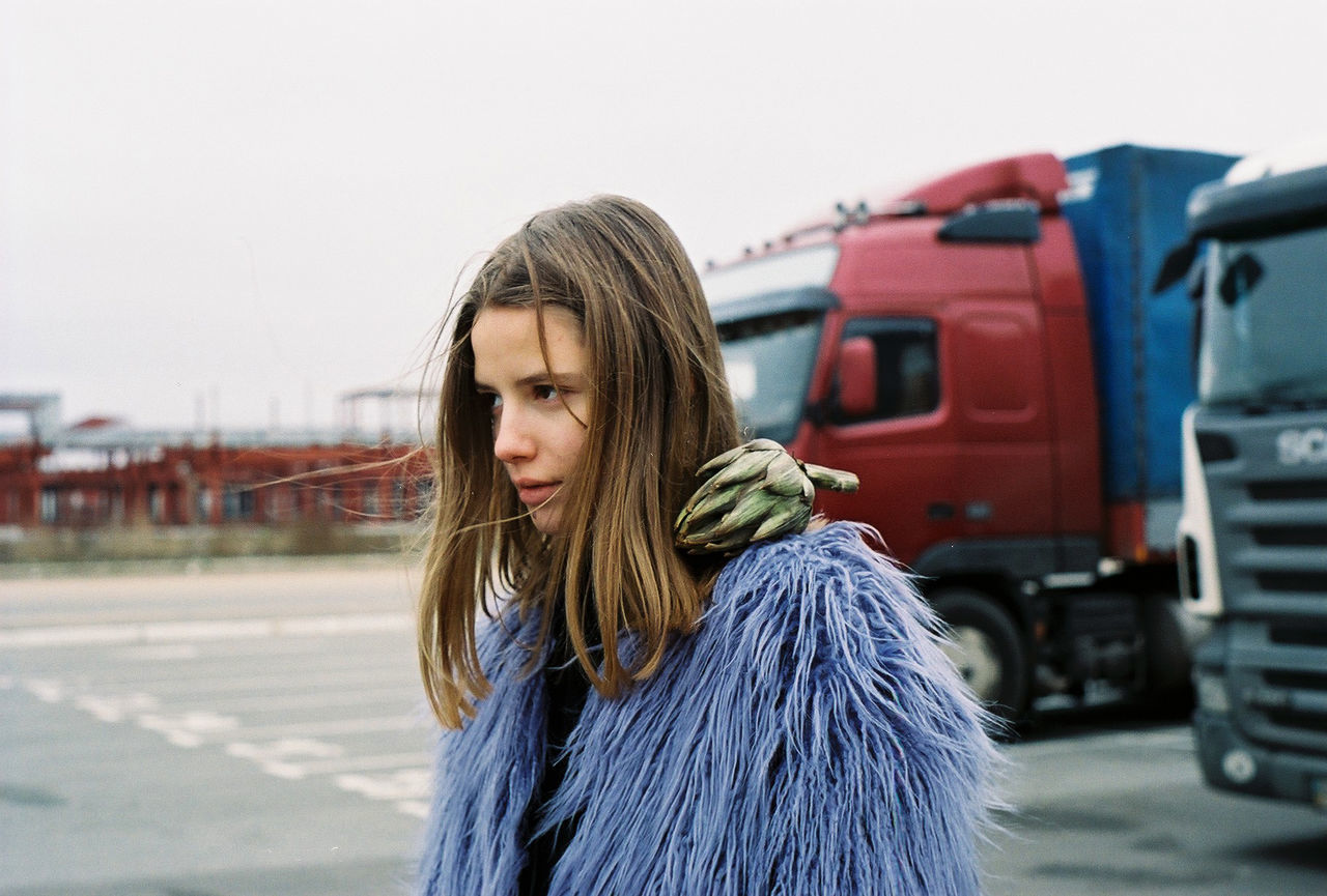 35mm film Analogue Photography Film Ishootfilm Parking lot Portrait of a Woman analog artichoke beautiful woman concentrated film photography filmisnotdead focused fur coat girls gloomy lifestyles outdoors people portrait warm clothing young adult young women