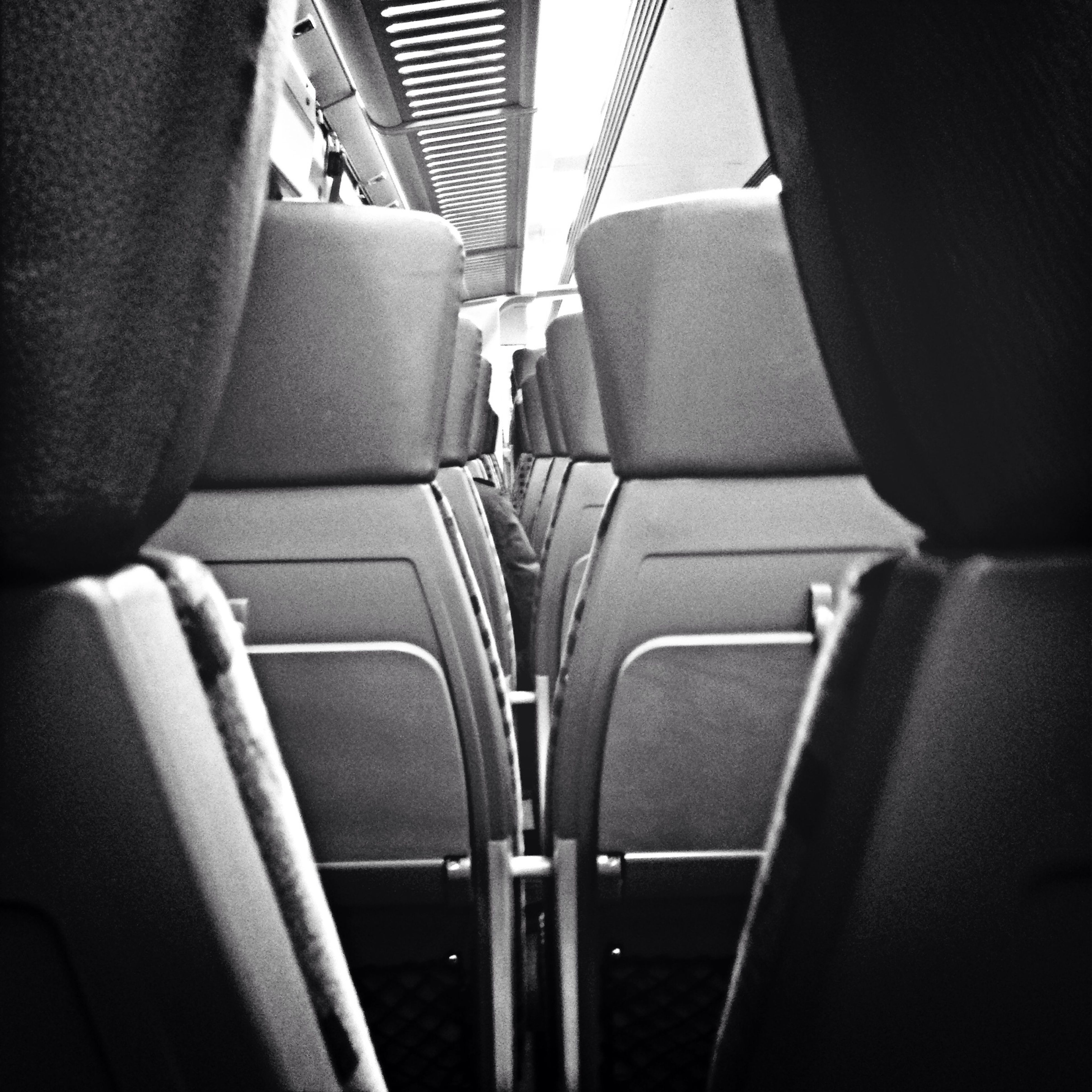 indoors, chair, seat, in a row, vehicle interior, vehicle seat, transportation, empty, repetition, absence, mode of transport, order, relaxation, day, side by side, window, travel, high angle view, no people, close-up