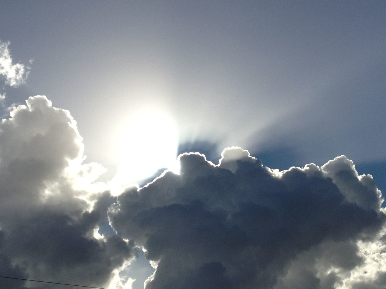 beauty in nature, nature, sunbeam, sky, cloud - sky, low angle view, sky only, scenics, majestic, backgrounds, sun, cloudscape, tranquility, sunlight, weather, heaven, no people, outdoors, day