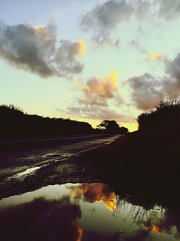 Sky Cloud - Sky No People Outdoors Tranquil Scene Silhouette Sunset Landscape Puddle Reflections Country Road Sunset_collection Sunset Silhouettes The Week On EyeEm Paint The Town Yellow Sunset #sun #clouds #skylovers #sky #nature #beautifulinnature #naturalbeauty #photography #landscape Sunset Collection Puddle Reflection Lost In The Landscape
