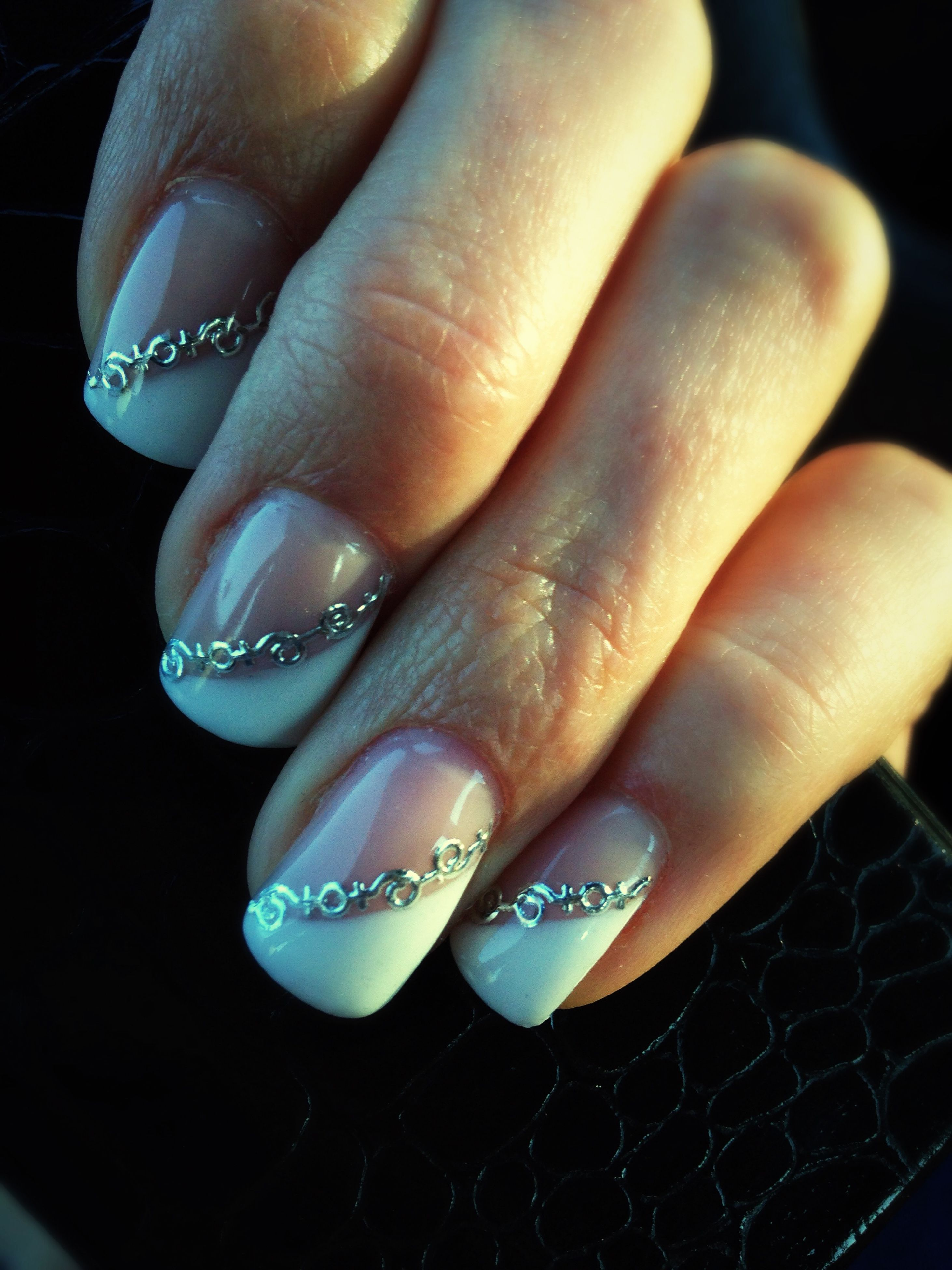 close-up, person, part of, indoors, black background, human finger, studio shot, cropped, focus on foreground, unrecognizable person, high angle view, detail, holding, ring, showing, pattern, still life