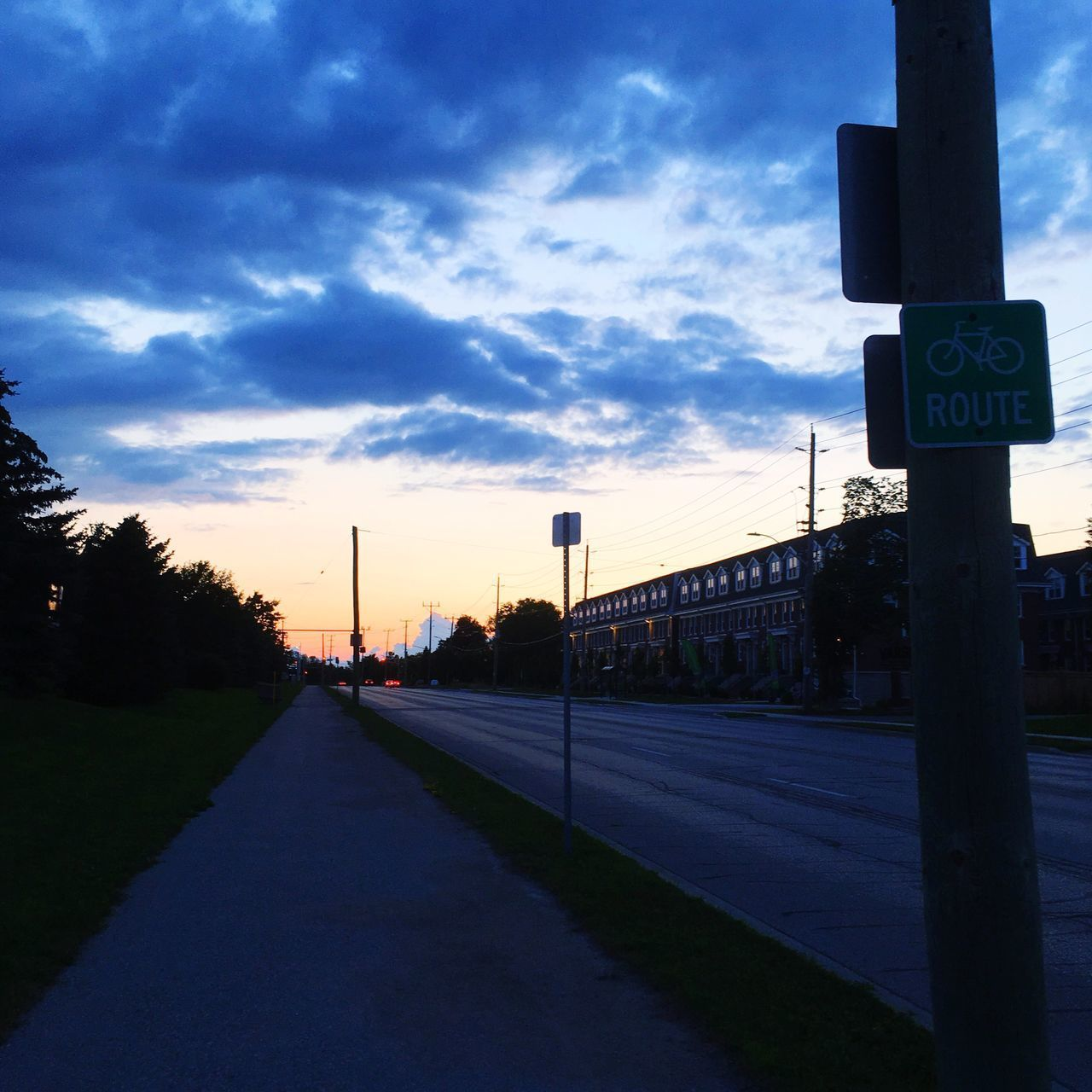 sky, road, transportation, cloud - sky, communication, sunset, guidance, the way forward, road sign, no people, outdoors, tree, day