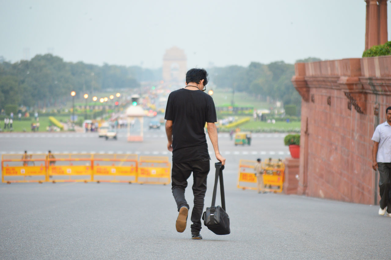 Adult Adults Only Bag Business Business Finance And Industry Businessman City Life Day Delhi Full Length GUCCI India Gate Men Nikon One Man Only One Person One Young Man Only Only Men Outdoors People Real People Rear View Sky Well-dressed Young Adult
