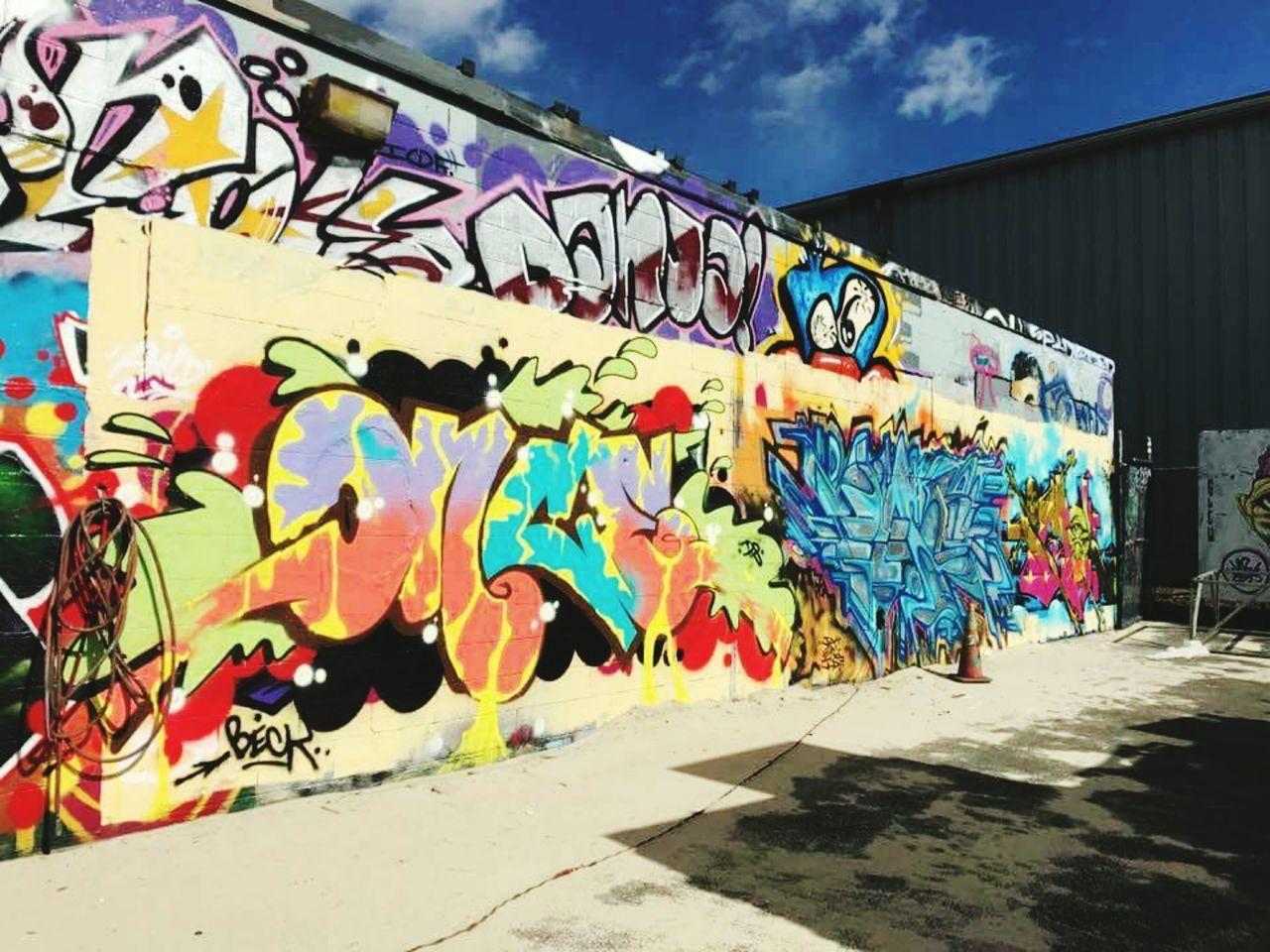 Graffiti Street Art Multi Colored Art And Craft Spray Paint Creativity Outdoors Day Lifestyles City Spraying Built Structure Artist People