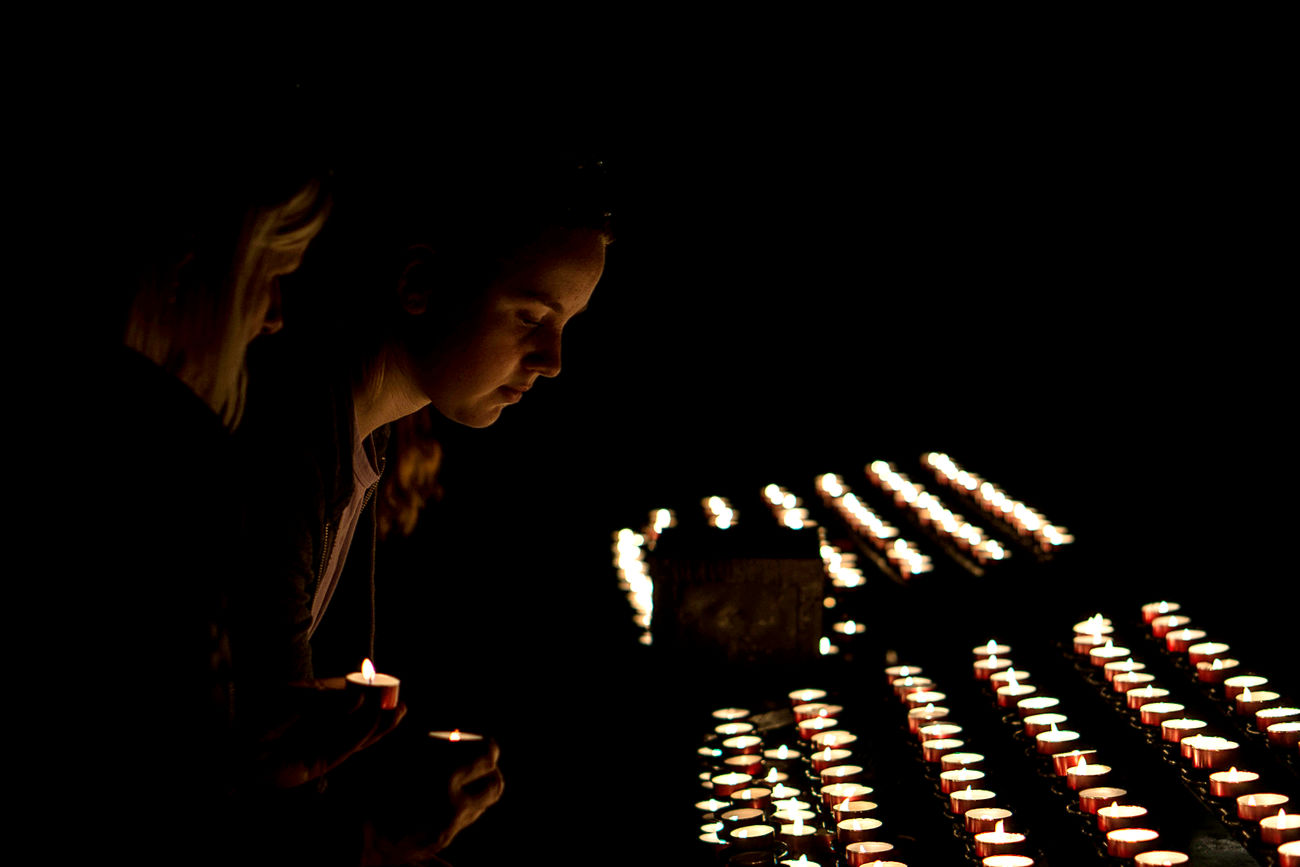 Symbolic lights Candles Candlelight Illuminated Light Black Background Girl Young Adult Indoors  Spiritual