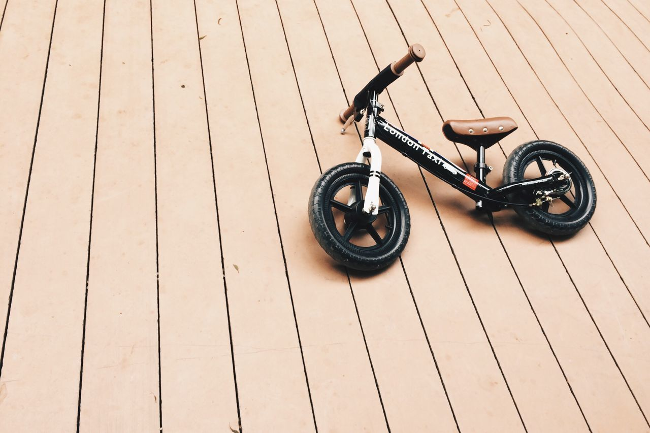 wood - material, hardwood floor, wheel, no people, childhood, indoors, day, close-up