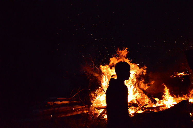 Blazing spirit. EyeEmReady Blaze Break The Mold Burning Danger Easter Fire Hello World Night On Fire One Person Silhouette Sparks Striving Flammen Feuer Out Of The Dark Outstanding Soul On Fire Light And Shadow