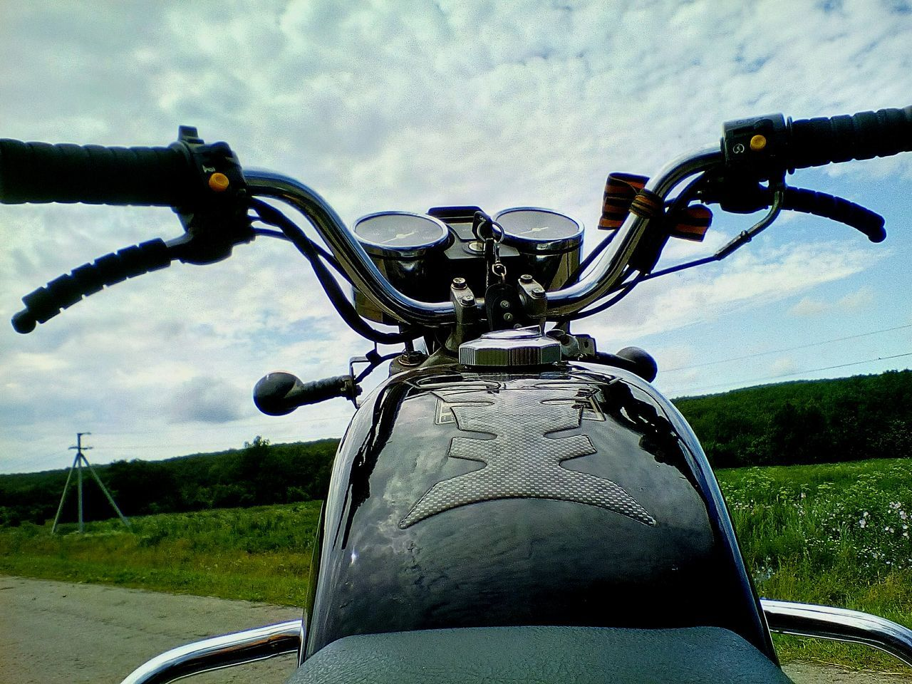 transportation, land vehicle, mode of transport, bicycle, handlebar, stationary, day, outdoors, close-up, travel, motorcycle, no people, sky, nature