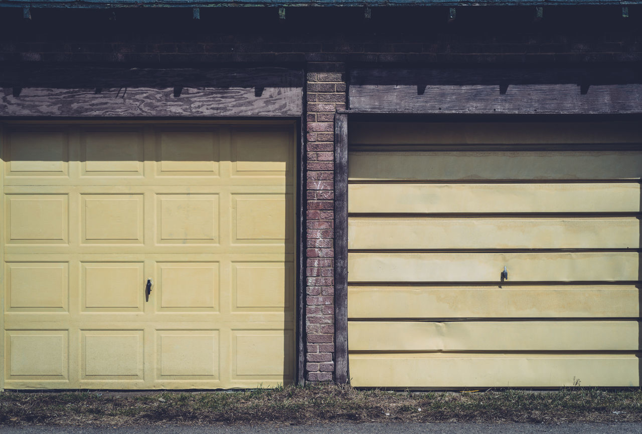 Building Built Structure Closed Garage Garage Door Garage Doors Outdoors Shadows Yellow Garage