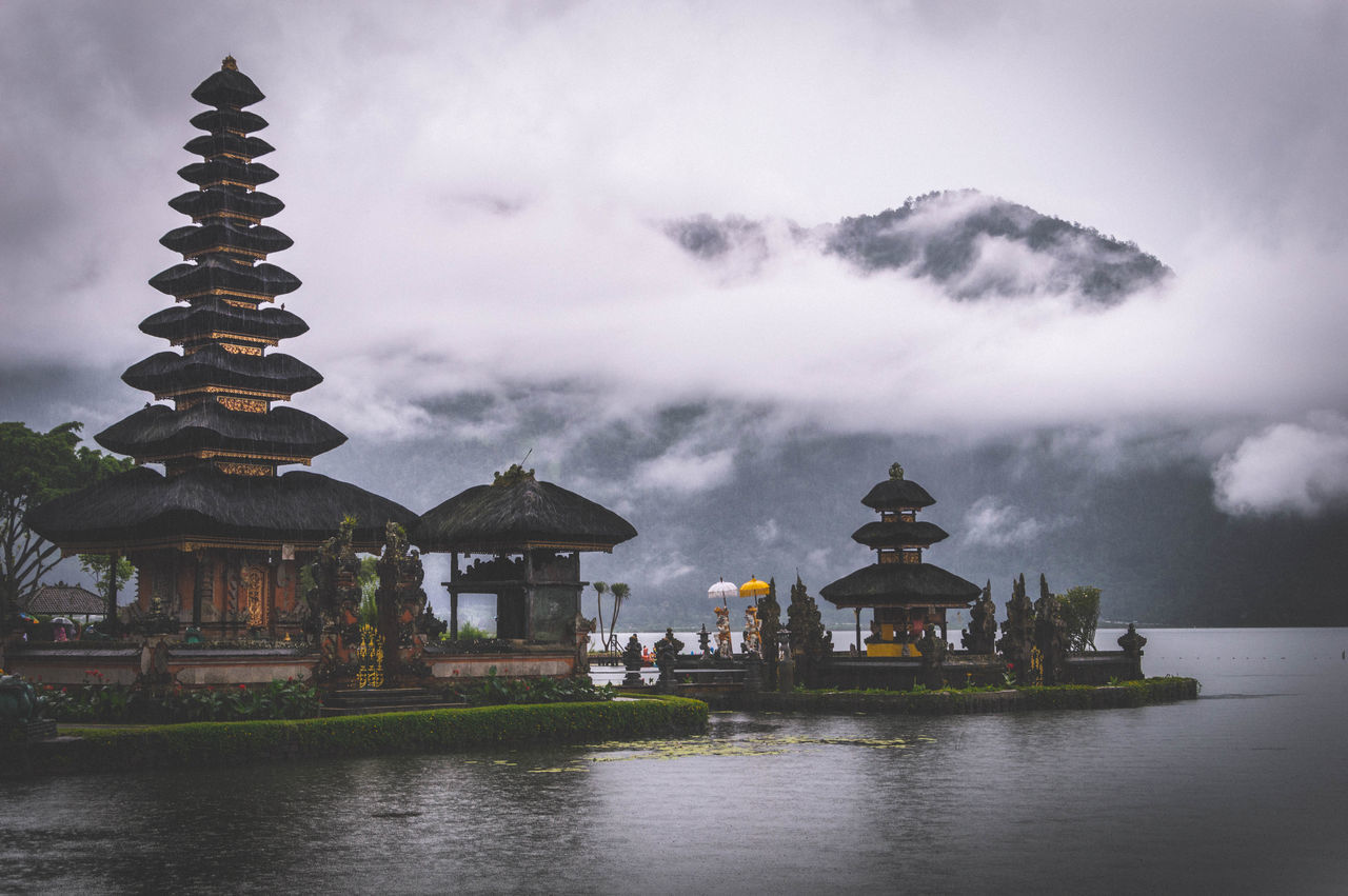 The wonderful Pura Ulun Danu Bratan temple on bali lies in the mid of a volcano lake. The weather on that day was terrible -cold, rainy and cloudy. But when looking at this picture today i am really happy that the weather gods had gone crazy on that day 😉 This picture is a re-edit Ancient Architecture Architecture Built Structure Check This Out Clouds Clouds And Sky Cloudy Dramatic Sky Hindu Lake Moody Sky Mountain Mountains Old Buildings Outdoors Rain Fine Art The Great Outdoors - 2016 EyeEm Awards Religious Architecture Temple Temple - Building Travel Weather Feel The Journey Fine Art Photography Finding New Frontiers Miles Away The Secret Spaces Art Is Everywhere Place Of Heart